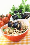 Spaghetti with mussels and fresh tomatoes