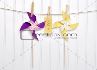 Summer Sale Concept Pinwheels with Sale Sign on Clothesline.