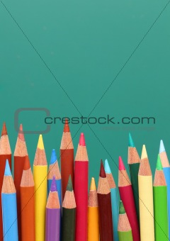 Group of pencils, blackboard behind