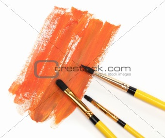 Three brushes and strokes over white