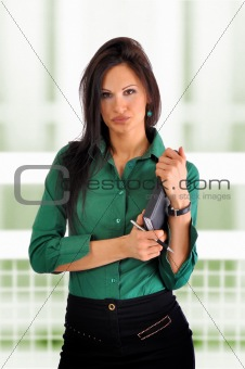 Business Woman takes notes