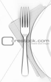 Fork near a plate