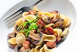 pasta orecchiette with fried champignons and bacon
