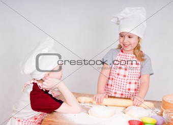 girl and boy  in chef's hats
