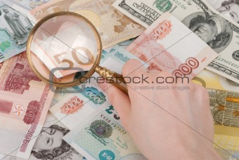 money and magnifier