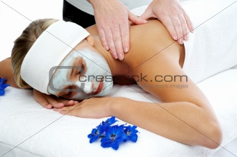Woman having a massage treatment at a beauty spa