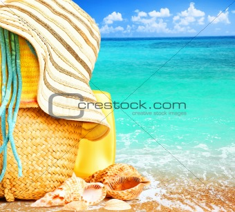 Beach items over blue sea