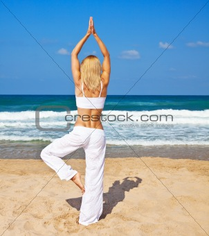 Healthy yoga exercise on the beach