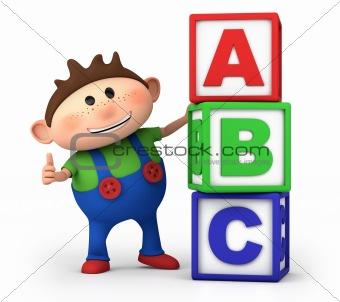 boy with ABC blocks
