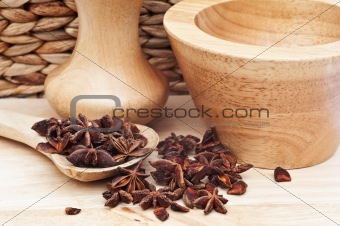 Star Anise in rustic kitchen setting with wooden utensils