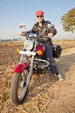 full length portrait of european biker in hinterland