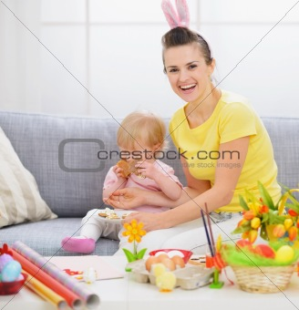 Mother with baby who like cookies a lot