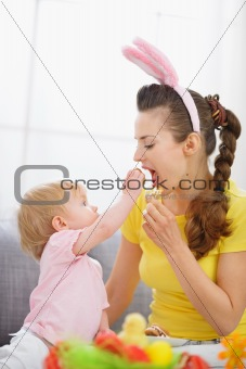 Baby feeding mother Easter biscuits