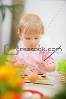 Color smeared baby painting Easter egg