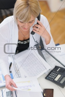 Senior business woman making phone call. Top view