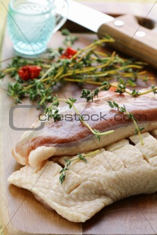 raw meat, duck fillet with spices and herbs