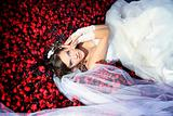 bride is lying in the flowers