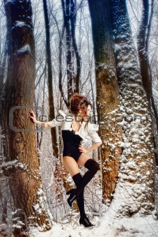 fairy girl in winter forest among the trees
