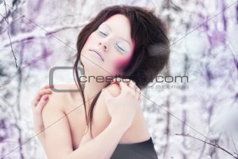 girl with beauty make-up in a fantasy winter forest