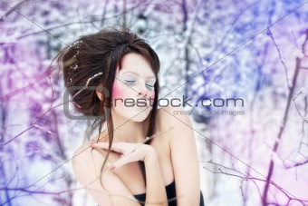 girl with make-up in a fairy winter forest