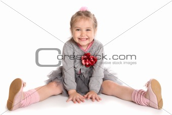 cute girl sitting on the floor and smiling