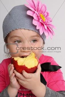 little girl bites the big apple