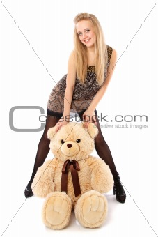 girl plays with stuffed bear