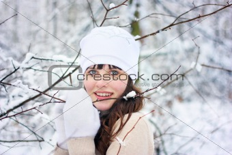 Beautiful girl in the woods among the trees