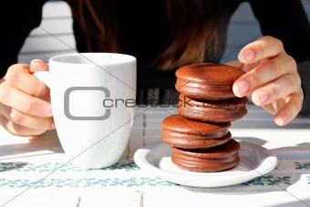 girl holding a cup of coffee and cake