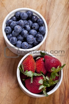 Bowls of blueberries and strawberries