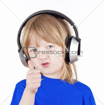 boy with long blond hair listening to music in headphones - isolated on white