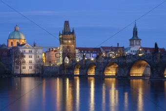 czech republic, prague - charles bridge and spires of the old town at dusk