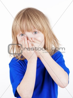 boy with long blond hair suprised, hands on his mouth - isolated on white