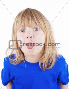 boy with long blond hair sticking out his tongue - isolated on white