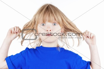 blond boy pulling his long hair looking - isolated on white