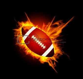 Realistic American football in the fire on black