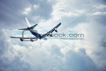 Airliner flying through the thick clouds