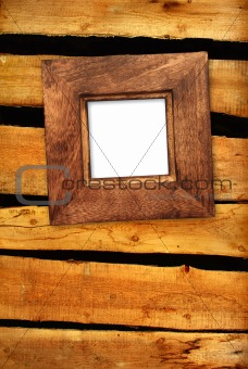Old frame on wooden wall