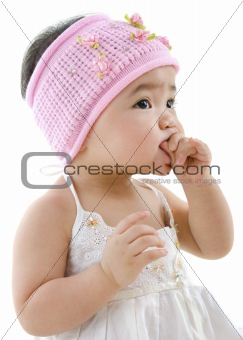 Cute baby girl eating