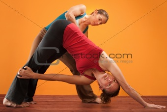Yogasana Instructor and Student