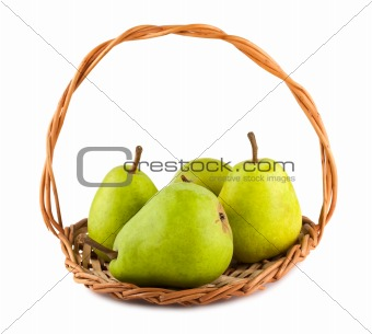 Green ripe pears in wicker basket
