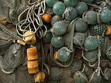 glass, plastic float, old fishing nets catch closeup