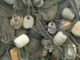 float, stone sinker old fishing nets catch closeup