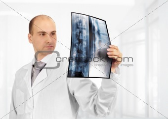 Young doctor examining an x-ray