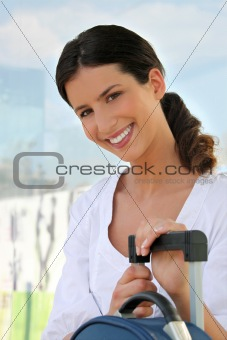 Smiling woman with a suitcase