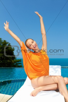 Fashion woman posing next to pool