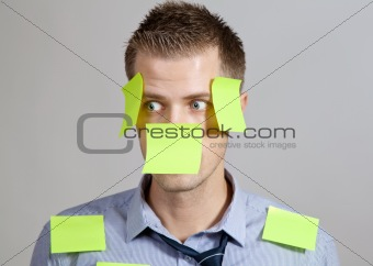 Businessman with post in notes