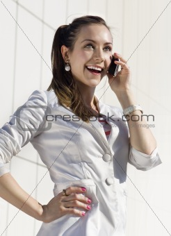 girl speaks on telephone