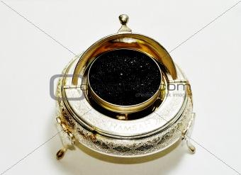 Black caviar in silver bowl