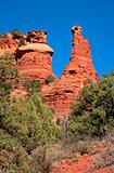 Red rock peaks tower over scrubs in the desert near Sedona.